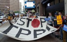 Protesters call for the rejection of the Trans-Pacific Partnership trade deal under negotiation in Atlanta, Georgia.