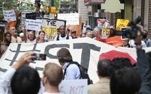 Protesters against the TPP trade talks outside the hotel in Atlanta where negotiations are taking place.