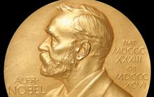 The Nobel Prize medal, which is an annual award for outstanding contributions for humanity in chemistry, literature, peace, physics, physiology or medicine