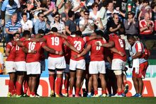 The Tongan team huddle together following their Rugby World Cup defeat to Argentina.