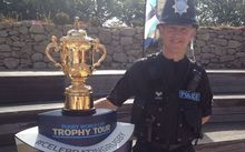 Sergeant Colin Taylor - Scilly Isles police - with the William Webb Ellis Cup