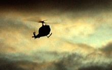 A helicopter flying in cloudy weather