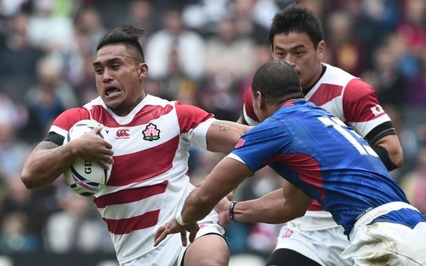 Japan centre Male Sau holds off Samoa's centre Paul Perez during their Rugby World Cup pool match.