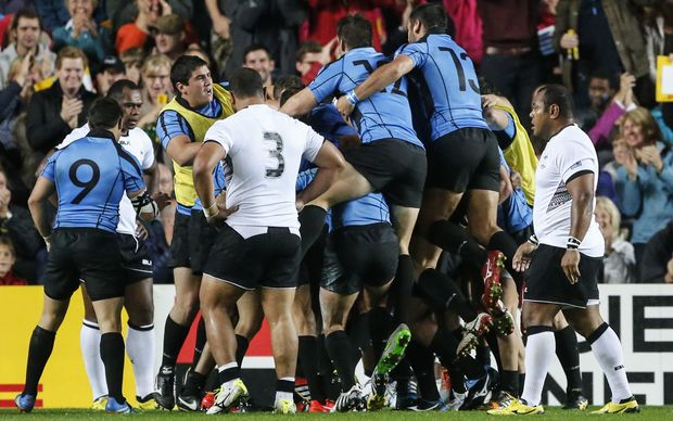 Uruguay players celebrate their first Rugby World Cup try in 12 years.