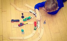 Anonymous boy playing with train generic child's play
