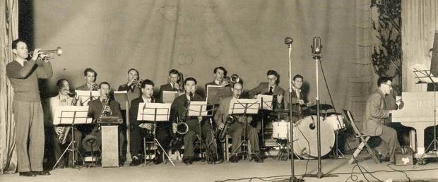 Doug Kelly's Radio Band playing at Christchurch's first Jazz Concert in 1951. Doug Kelly on the far left on trumpet. Gerald Marston is first on the left in back row. Doug Caldwell at the piano.