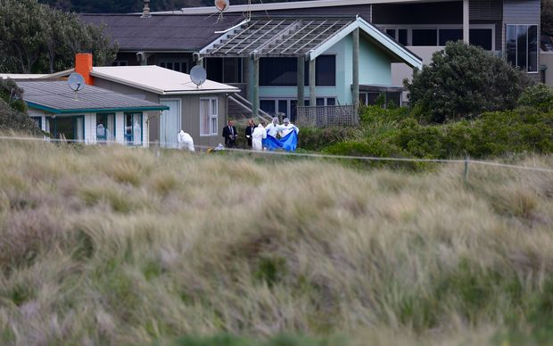Forensic staff begin their investigation at the site where 10-year-old Alex Fisher's body was found.