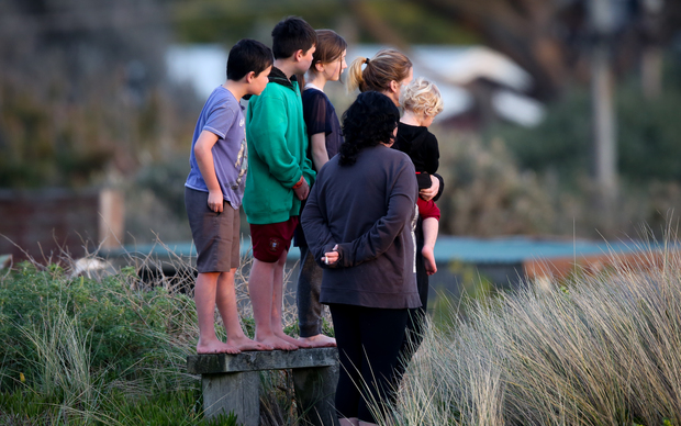 Waitarere residents look on at the police cordon.