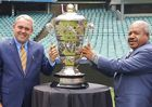 Papua New Guinea Minister for Sports, Honourable Justin Tkatchenko, and National Capital District Governor, Honourable Powes Parkop, pose with the Rugby League World Cup.