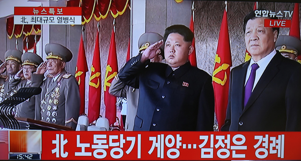 This screen grab taken from Yonhap News TV shows Kim Jong-Un (C) and Liu Yunshan (R).