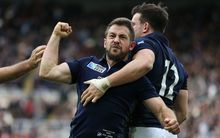 Scotland captain Greig Laidlaw celebrates his match-winning try, flanked by Tommy Seymour (L) and Matt Scott (R) late in the game against Samoa, Rugby World Cup, St James' Park, Newcastle 10 October 2015