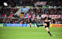 Dan Carter takes a shot at goal in the Rugby World Cup match against Tonga.