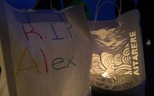 At the end of the vigil people lit candles in paper bags which were adorned with mesages of support in memory of Alex Fisher.