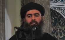 "An image grab taken from a propaganda video released on July 5, 2014 by al-Furqan Media allegedly shows the Islamic State leader Abu Bakr al-Baghdadi adressing worshippers at a mosque in  Mosul. MANDATORY CREDIT ""AFP PHOTO / HO / AL-FURQAN MEDIA """