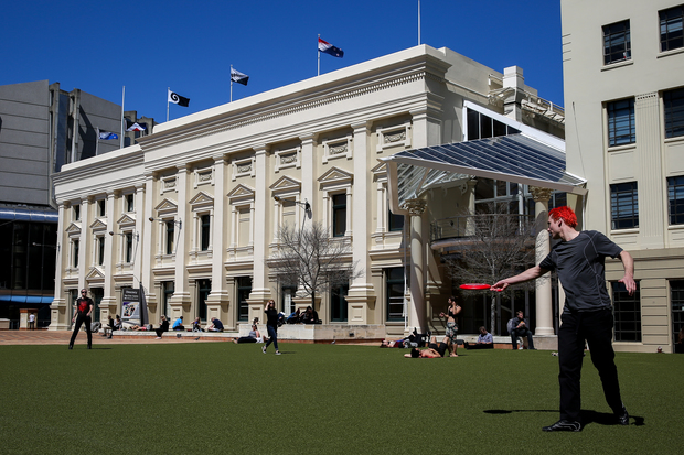 Wellingtonian's embracing a hot lunch break as the 5 flags up for debate fly high on top of Wellington's Town Hall.