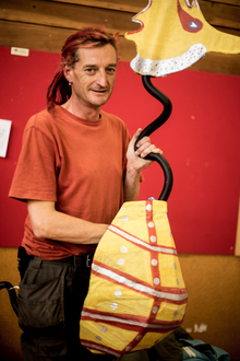 Jim Richards with a seahorse made from recycled cardboard and bicycle handlebars