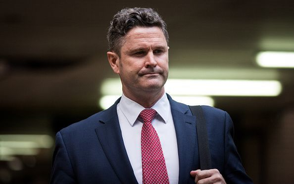 Chris Cairns heads into a London court to face trial for perjury.