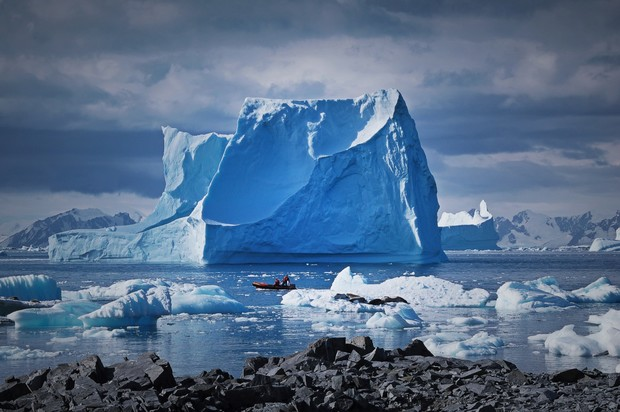 Icebergs grounded near Adelaide Island, Antarctica Peninsula. The Antarctic Peninsula is one of the most rapidly warming parts of the continent. By the end of this century, Antarctica could contribute up to 40 centimetres to sea level rise.