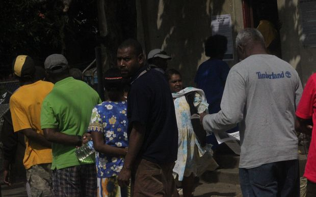Voters at Dumbea Hall polling station