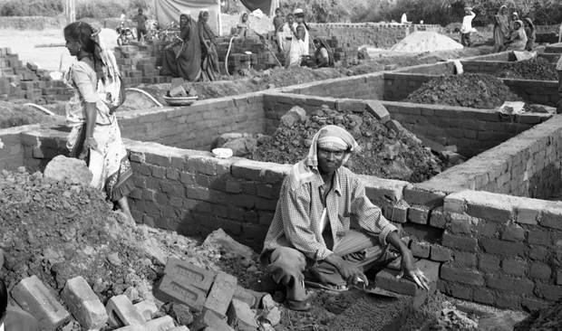 Building a new village for the dispossessed after the Gujarat Massacres.