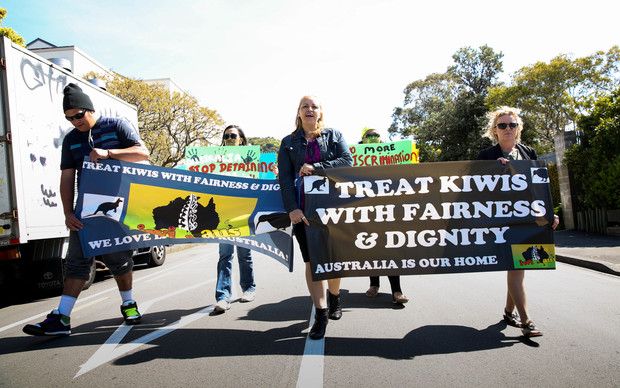Erina Morunga and protesters march from the Australian High Commission