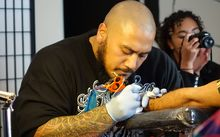 Tattoo artist Chris Amosa