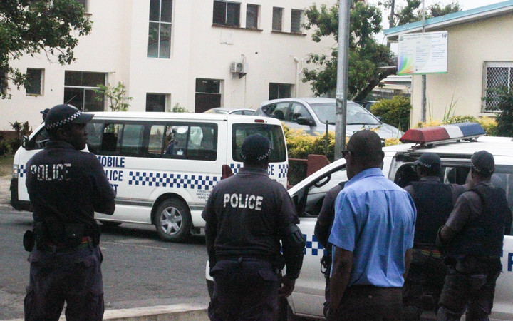 A police van arrives at Vanuatu's correctional facility carrying the arrested MPs.