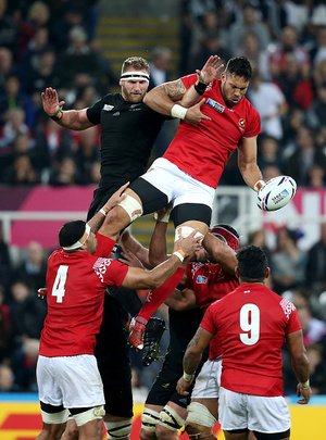 All Black Kieran Read and Joseph Tuineau of Tonga jump for a line out during the 2015 Rugby World Cup Pool C match between New Zealand and Tonga.