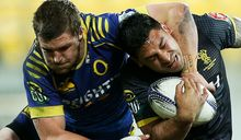 Marvin Karawana of Wellington is tackled by Michael Collins of Otago.