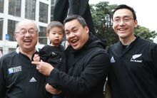 All Blacks fans the Chiu family after the game against France.