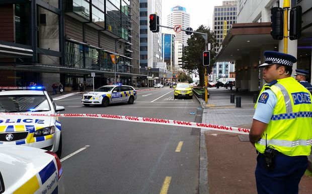 Police at the scene of a fall from a building on Auckland's Albert Street.