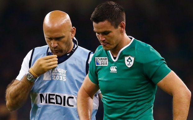 Johnny Sexton leaves the field injured in Ireland's RWC match against France.