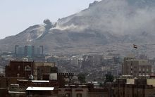 Smoke billows following an air-strike by the Saudi-led coalition targeting an arms depot on the Nuqom mountain overlooking in the Yemeni capital Sanaa.