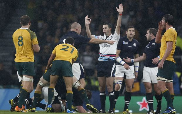 South African referee Craig Joubert (C) awards the final penalty to Australia during a quarter final match of the 2015 Rugby World Cup between Australia and Scotland at Twickenham stadium, southwest London on October 18, 2015. AFP PHOTO / ADRIAN DENNIS