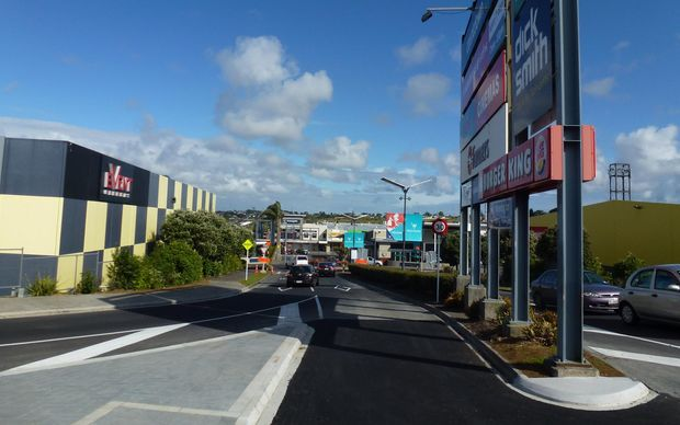 Auckland Transport says the sign's steel supports are in the path of traffic crossing the intersection, and that lane is closed until it's moved.