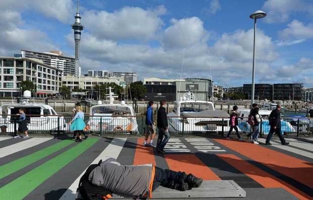 A man sleeps rough on Auckland's waterfront.