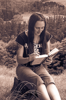 a successful self-published author of dark fantasy and paranormal romance