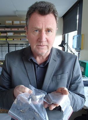 Archaeologist Ian Barber holds kuri bones collected from midden sites in the South Island.