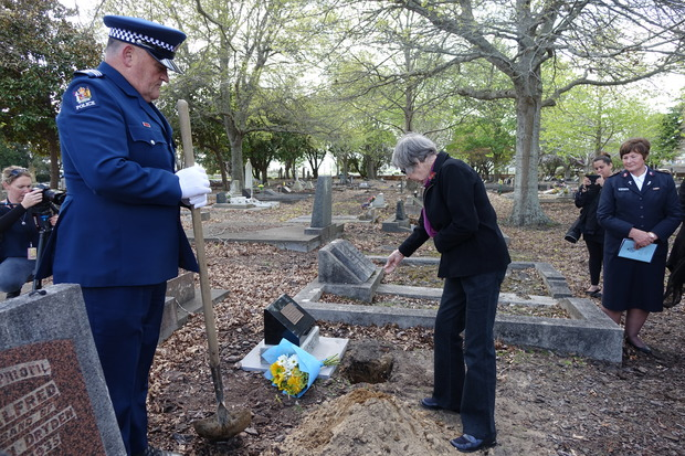 Joyce Sanson, whose grandfather found Christobel Lakey's body, pays her respects as Samuel Lakey's remains are interred at Huntly Cemetery.