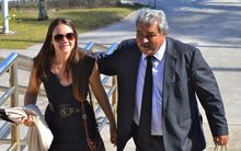 Teina Bishop supported by his daughter Tania Bishop outside the High Court in Rarotonga