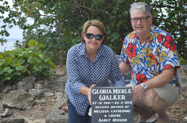 Cate Walker and Paul Morrissey beside the grave of Cate's late mother Gloria Walker. Cate has repainted and refreshed her mother's grave since it was left abandoned.