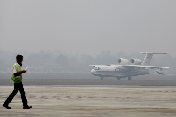 A Russian-made Beriev Be-200 amphibious firefighting aircraft, one of two rented by the Indonesian government to combat its forest and agricultural fires, taxis following its arrival