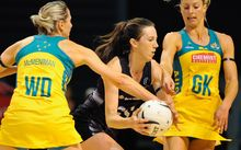 Silver Ferns shooter Bailey Mes battles with Australian defenders Laura Geitz (right) and Claire McMenniman.