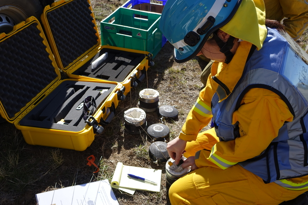 Scion fire scientist Veronica Clifford is preparing fire-proof canisters, developed in collaboration with the University of Canterbury's engineering services, that hold instrumentation to track the fire in the burn plots.