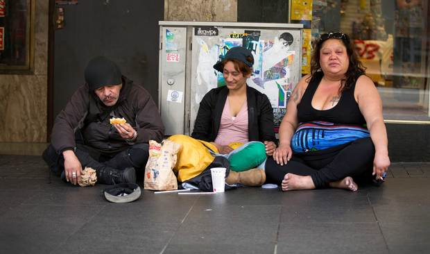 A group of people begging on Auckland's Queen Street.