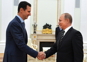 Russian President Vladimir Putin (R) shakes hands with his Syrian counterpart Bashar al-Assad (L) during their meeting at the Kremlin in Moscow on October 20, 2015.