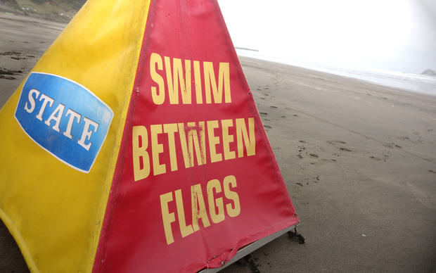 Swimmers at Auckland's Muriwai Beach are told to 'swim between the flags'.