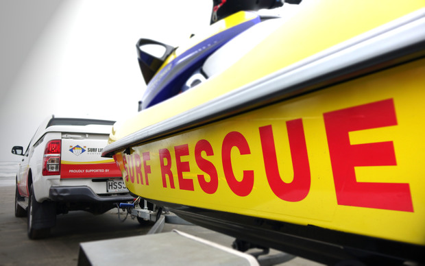A Surf Life Saving lifeguard rescue boat is towed to Muriwai Beach, Auckland.