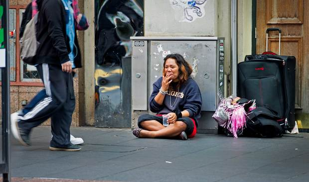 A woman begging in central Auckland.