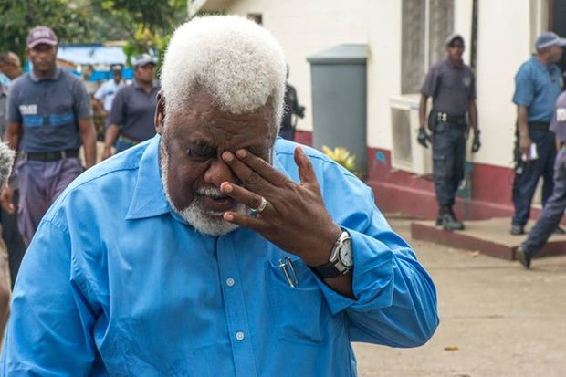 Willie Jimmy wipes away a tear as he exits, head bowed, from the Supreme Court. Alone of the 15 MPs facing sentencing, Mr Jimmy's sentence of 20 months was suspended for two years.